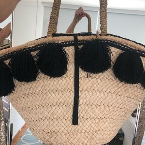Anthropology large straw bag with black Pom poms